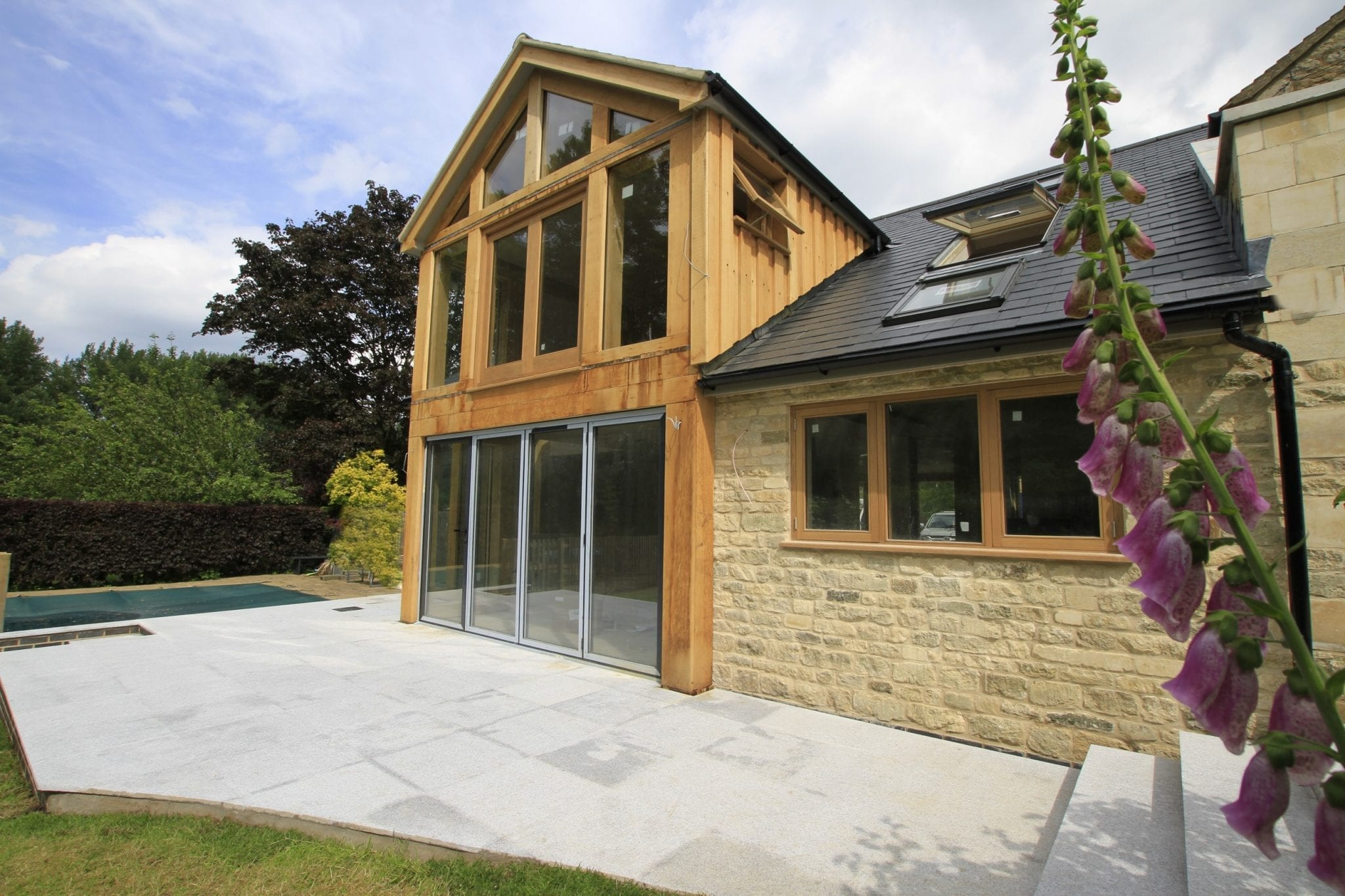 Oak framed extension forms large glazed living space for for Extension architecte